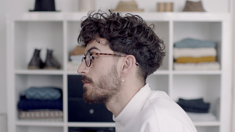 Guy with messy hair, in profile.