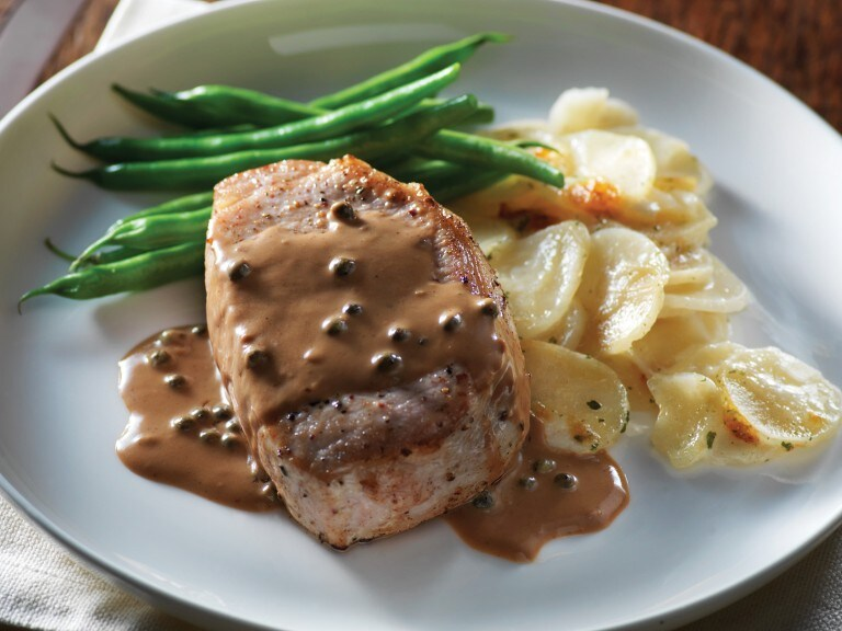 Pork chop smothered in balsamic and cracked pepper sauce