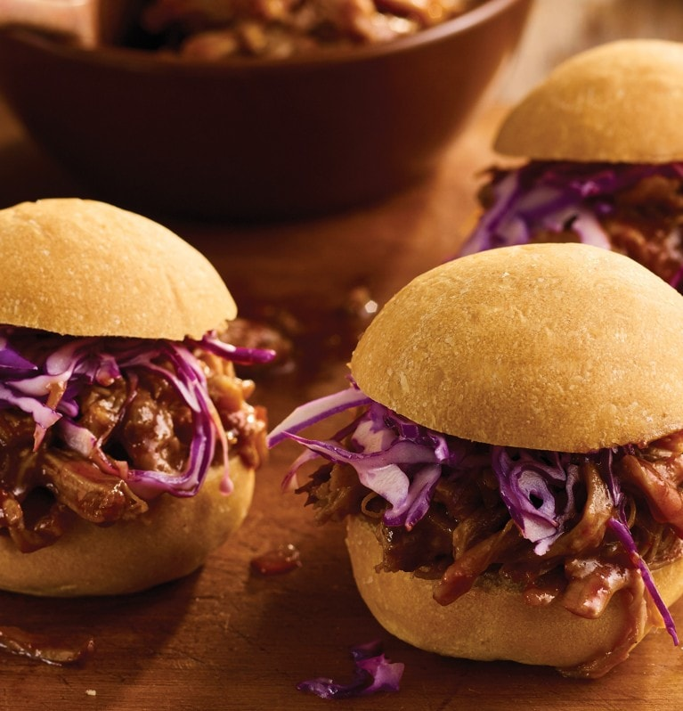 Chipotle slow cooker pulled pork sliders served with purple coleslaw on top