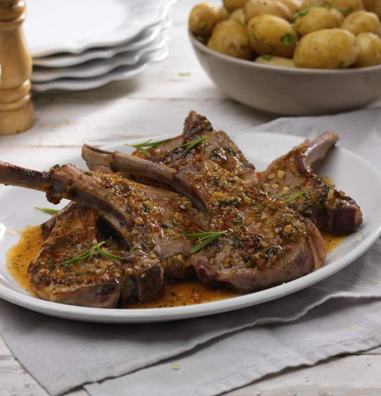 Grilled lamb chops coated with stock cube and mixed herbs