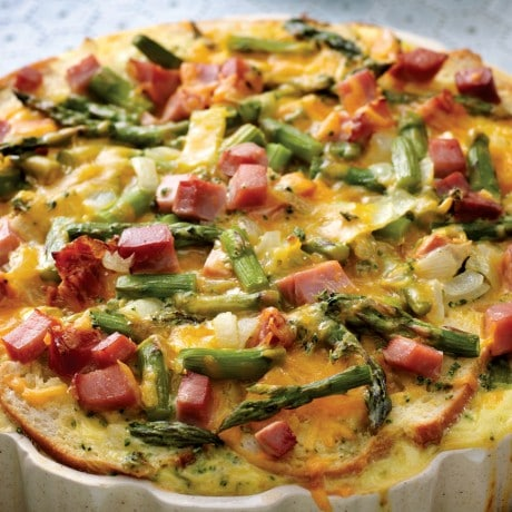 Baked strata with asparagus tips and chopped ham on top