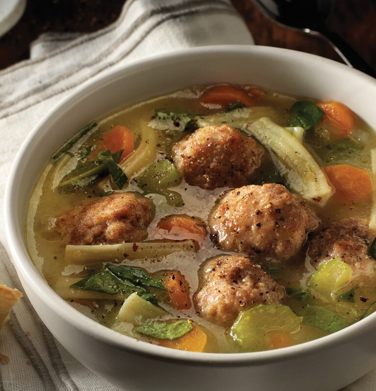 Chicken meatballs, nooddles and vegetables in broth