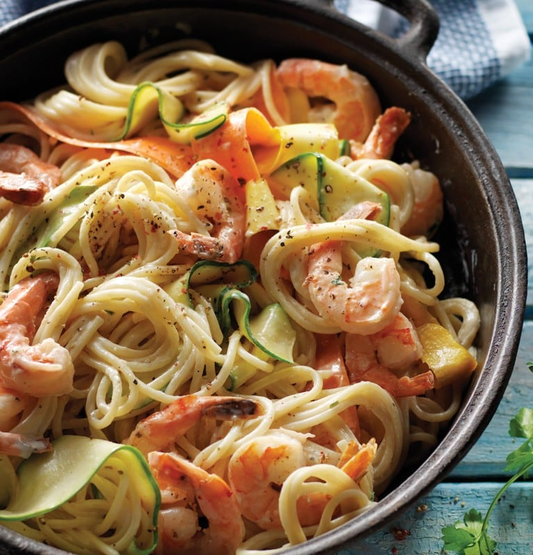Spaghetti with shrimp and vegetable noodles in cast iron pan