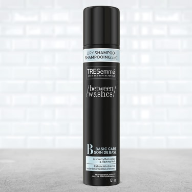 A 121 g bottle of TRESemmé Fresh Start Basic Care Dry Shampoo front of pack image