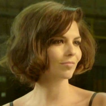 Woman with dark bown hair in a faux bob hairstyle