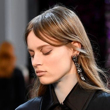Model with curtain fringe bangs