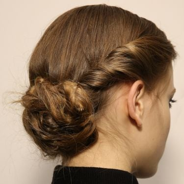 Model with chignon bun