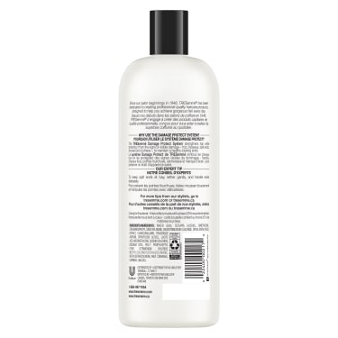 A 28oz bottle of TRESemmé Damage Protect Conditioner back of pack image