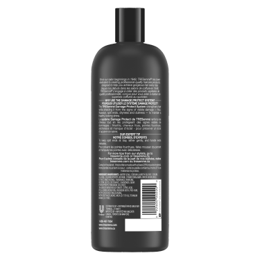 A 28oz bottle of TRESemmé Damage Protect Shampoo back of pack image