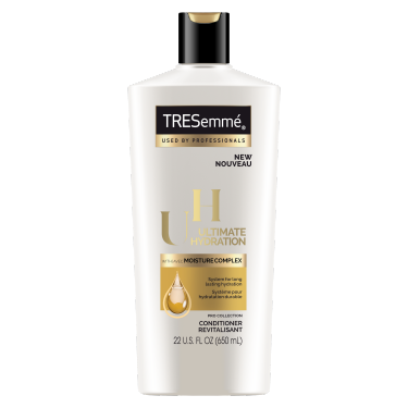 A 22oz bottle of TRESemmé Ultimate Hydration Conditioner front of pack image