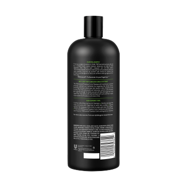 A 28oz bottle of TRESemmé Flawless Curls Shampoo back of pack image