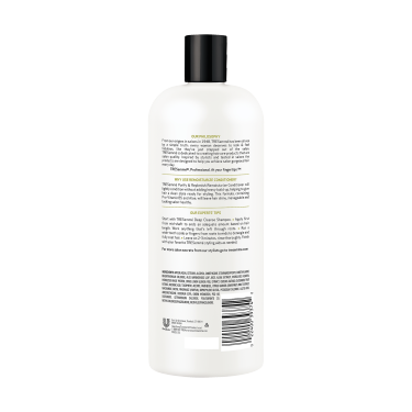 A 28oz bottle of TRESemmé Purify and Replenish Deep Cleansing Conditioner back of pack image