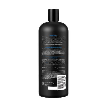 A 28oz bottle of TRESemmé Touchable Softness - Smoothing Shampoo for Shiny Hair back of pack image