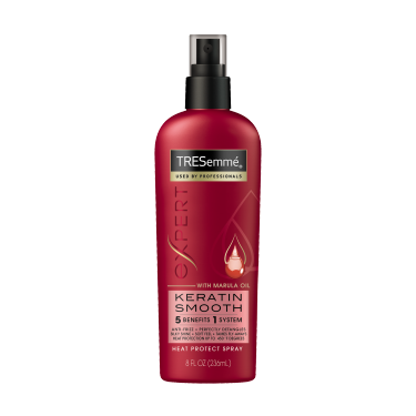 Imagen al frente del paquete - una lata de 8 oz TRESemmé Keratin Smooth Heat Defense Spray - Imagen al reverso del paquete - una lata de 8 oz TTRESemmé Keratin Smooth Heat Defense Spray